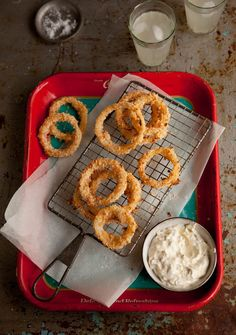 Crispy oven roasted onion rings with a jalapeno dip on DrizzleandDip.com