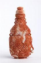 A carved cerasuol coral snuff bottle, China, 20th Century