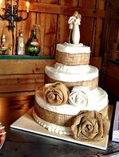 Rustic cake. I am not in love with the burlap accents, but I'm pretty sure the cake topper is what we have picked out :)