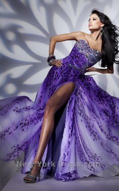 Free-flowing strapless gown with dynamic diagonals by Tony Bowls Paris