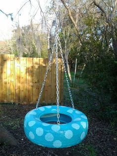 polka dot tire swing (maybe not polka dot but awesome idea!)