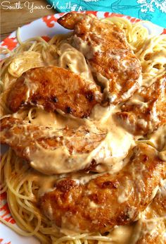 Chicken Lazone! Seasoned chicken pan-fried in butter with a super easy cream sauce served over pasta.