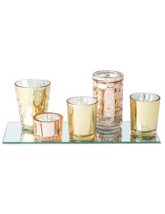 Add a contemporary and on-trend statement to your home decor with this mirror tealight holder set from the Tilly@home Sahara range.
