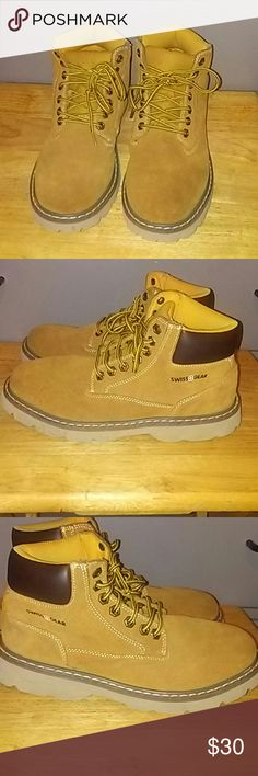 Swiss Gear Men's Light Weight Hiking Boots These Swiss Gear boots are preowned ,but in good condition.Very light weight boot. No Box/Tan Leather upper balance,man made materials.Lace up boots Swiss Gear Shoes Boots