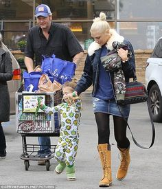 Pick up a pretty printed tote like Gwen Stefani. Click 'Visit' to buy now. #DailyMail