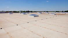 Flat roof on industrial hall. Flat roof with skylight and hydro insulation membr , Roofing Companies, Roofing Services, Roofing Contractors, Roofing Estimate, Real Estate Signs, Commercial Roofing, Outdoor Signage, Water Pond, Roof Repair