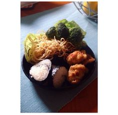 #manikinhead #food Chicken nuggets sticky rice wrapped in nori fried broccoli and some noodles aglio e olio.