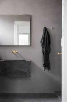 Gray minimalistic bathroom | Norm Architects