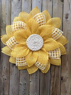 "This beautiful Yellow daisy wreath with a cream colored cord center is made with poly burlap and would look beautiful on any door or wall, perfect for every day or to give as a special gift. Measurements are approximately 22"" in diameter. Comes with a backing to protect your door and a ribbon to"