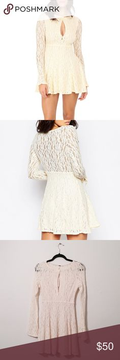 FREE PEOPLE Shearling Dress A cute whimsical dress from Free People that has a wonderful lace design. New with tags and the measurements are 33 inches in total length and 13.5 inches in chest area. Free People Dresses