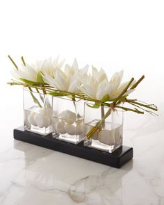 """#ONLYATNM Only Here. Only Ours. Exclusively for You. Handcrafted faux-floral arrangement. Synthetic-silk flowers and elephant reed. Three glass vases. Acrylic """"water."""" 21""""W x 8""""D x 11""""T. Imported."""