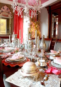 a dining room glammed out in pink for Christmas via Bright Bold Beautiful ~ Christmas Home Tours | Lillian Saadatmand