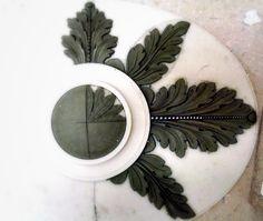 A decorative medallion in progress.