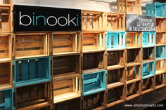Rustic wooden boxes transformed into creative wall of displays for Binooki publishers. Designed by Albert Concepts Interior Architecture, see www.albertconcept... for more information. #Weinkisten #Weinkiste #Interior #Interiordesign #expo #Display #homedecor #shelf #tradestand #woodenboxes #woodencrate