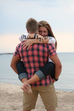 Engagement, love, couples, photography, beach, lighthouse, sand, water, lake, holding, hugs, Photos by DD, marriage, ring, pose, natural, Lake Michigan, perfect, ideas, beautiful, plaid, sunset