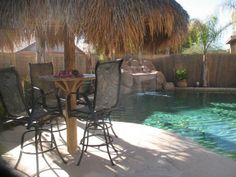 Lovely Island Paradise. Arizona vacation rentals. We would like to invite you to enjoy our vacation home in sunny Surprise,  AZ. (North West Phoenix)    Relax in the back yard in our salt water pool with a waterfall and cook up something good on the g vacation rental.