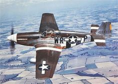 'The Iowa Beaut,' a P-51B of the 354th Fighter Squadron flown over the English countryside by Lt Robert E Hulderman, mid-1944. A different pilot in this plane was lost near Rechtenbach, Germany, Sep 11, 1944.