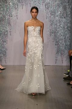 Monique Lhuillier's fall 2016 collection is brand new -- and we've got pictures! Click to see all the styles we love, including this fluid strapless gown (that would look fantastic for a beach wedding...)
