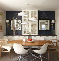 Large round dining room table with IKEA side board