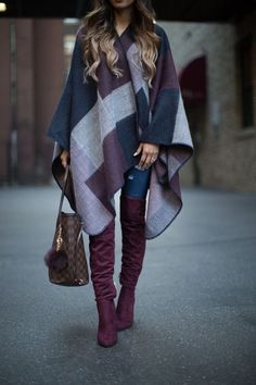 Poncho in blue, purple and gray checks with purple over the knee boots.
