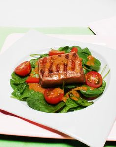 Grilled Salmon and Spinach Salad: Combine the flavors of sweet orange juice, nutty sesame oil, and spicy ginger to dress a delectable bed of baby spinach and fresh salmon.