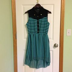 """Sleeveless collared hi low dress NWOT Cute sleeveless black and teal green hi low dress with stripes. It has 6 gold buttons and 2 gold corners of the collar. Material is sheer and has a dress lining. Size L but fits like a medium. NWOT. Approx. 41"""" long. Dresses High Low"""