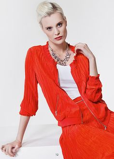 Jacket in orange. KRISS Sweden