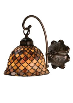 8 Inch W Tiffany Fishscale Wall Sconce - 8 Inch W Tiffany Fishscale Wall SconceA Louis Comfort Tiffany studio classic fishscalepattern reproduced in variegated Tortoiseshell ofAmbers and Burgundy. This handsome stained glass shade is used with Mahogany Bronze hand finished hardware. Aversatile one light wall sconce that will complementany color or style. Theme: VICTORIAN TIFFANY NOUVEAU Product Family: FISHSCALE Product Type: WALL SCONCES Product Application: ONE LIGHT Color: PABA MAHOGANY…
