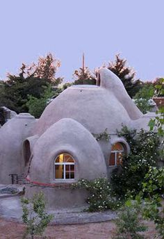 Eco-Domes.  Adobe, or Cob, 400sq.ft homes of connecting domes.