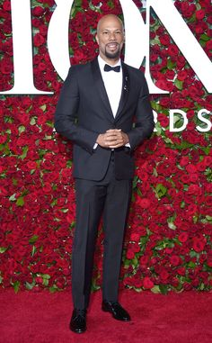 Rapper Common wore a classic evening ensemble featuring a very beautiful shawl-lapel jacket. The fashion lesson you can take from his Tony Awards look is that wearing a one-button jacket will make you look more youthful than a two- or three-button jacket would.