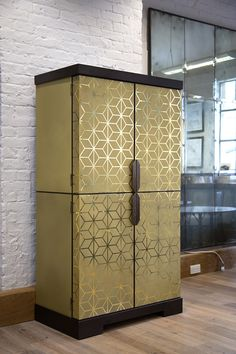 Art deco inspired cocktail cabinet with an exterior façade clad in brass panelling etched with a Deco Furniture, Cabinet Furniture, Metal Furniture, Furniture Design, Contemporary Cabinets, Modern Cabinets, Modern Interior Design, Interior Design Inspiration, Modern Buffet