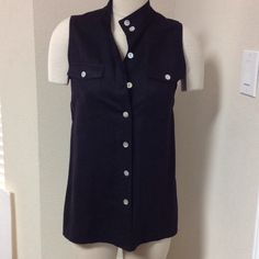 Black linen sleeveless button down Has side slits, she'll buttons, 2front pockets, stand up collar Tops Button Down Shirts