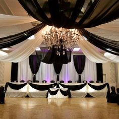 Black and white fabric draped ceiling - gorgeous! A classically elegant way to set the scene for a party!
