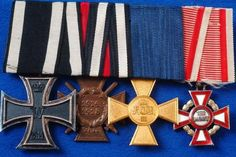 "This is a rare German WW1 officer's medal bar 5"" wide bar with double wrapped ribbons, 1914 iron cross 2nd class 43mm wide with dark patina frame and magnetic black centres, Hindenburg cross with swords, Officer's Prussian 25-year long service cross and a rare Austrian Military Merit Cross with red and white enamel. This belonged to a German army officer who saw duty with the Austro-Hungarian forces during WW1"