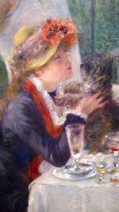 Aline Charigot, is in the foreground playing with a small dog. On the table is fruit and wine. The seamstress Aline Charigot, holding a dog, sits near the bottom left of the composition. Renoir later married her.