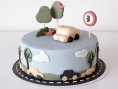Birthday cake 'Auto's'!  : Again, another cake!    This time I made a birthday cake for a 3 year old little boy who loves cars.    For the interior of the cake I used banana cake filled with vanilla-chopped pure chocolate Swiss meringue buttercream, raspberry confiture, lemoncurd and Creme de framboises (raspberry liqueur) for the cover I used marzipan.  All decorations are also made with marzipan, except for the 3 sticks everything is eatable!   our_daily_food