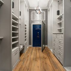 Master Closet with Walk in Safe - contemporary - closet - houston - Jonathan Ivy Productions.  Would like a closet safe/built-in