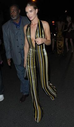 100 best dressed of 2014 - Rosie Huntington-Whiteley in a Balmain vertical stripe jumpsuit with deep V