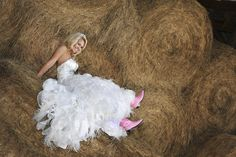 She may be dressed like a princess, but she's a true country girl at heart. http://www.greatamericancountry.com/living/lifestyles/country-weddings-brides-in-boots-pictures?soc=pinterest