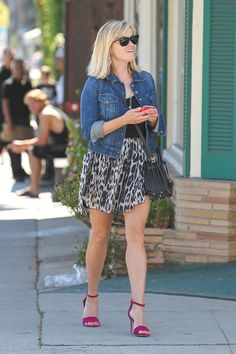 Reese Witherspoon's denim jacket puts a casual spin on her flirty spring dress and strappy heels. Splash News  - HarpersBAZAAR.com