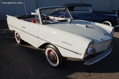 1967 Amphicar~An amphibious automobile, it was the first such vehicle mass-produced for sale to the public starting in 1961. The German vehicle was designed by Hanns Trippel and manufactured by the Quandt Group from 1961-1968 with  3,878 built. Housed a Triumph 4 cylinder engine.