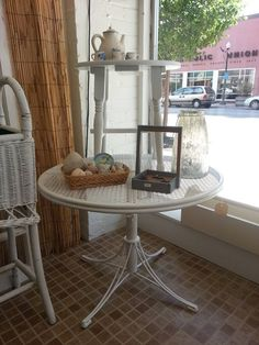 This white metal table raises from cocktail height, to dining height!