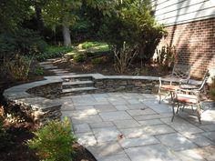 square flag patio with natural stacked wall