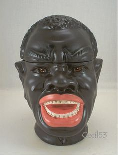 LAUGHING BLACK MAN TOBACCO JAR/ COOKIE CANISTER.