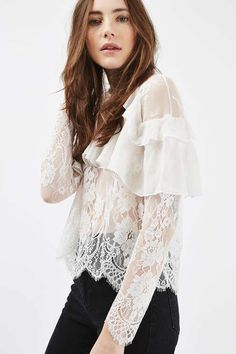 Victoriana details are so on trend right now, and we love the way they're styled on this pretty blouse in all-over lace with elegant frills to the front and shoulders. Pair with high waisted jeans and block heels for a look that works from day to night. #Topshop