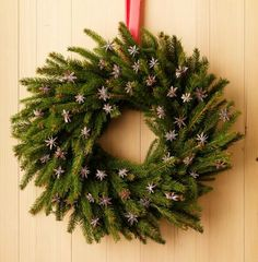 star anise and a simple evergreen wreath