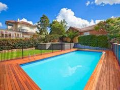 In-ground pool design using timber with decking & hedging - #swimmingpools #decks