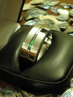 hand crafted stainless steel mens ring with Abalam shell inlay. $425.00, via Etsy.