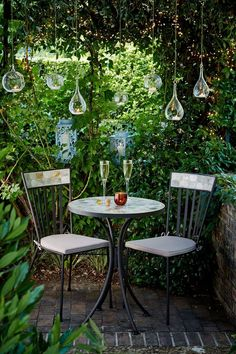 "Lighting is the simplest way to create mood in a garden. A few hurricane lanterns or tea lights hung from a tree can add instant romance to a summer's evening. [i]Image from [link url=""http://www.johnlewis.com""]John Lewis[/link].[/i] #BalconyGarden"