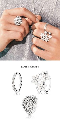 Anchor your ring look with the same motif and metal. Opt for summery flowers – we love the daisy rings – in gleaming silver and crisp white. Balance smaller rings on top. #PANDORA #PANDORAring #PANDORAmagazine